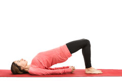 Bridge pose. Caucasian woman doing bridge pose in yoga. Isolated on white background Stock Photo