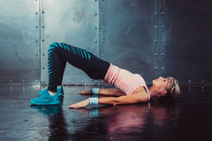 Bridge pose sporty woman doing fitness workout. Yoga stretching gymnastics exercise Royalty Free Stock Photo