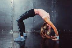 Bridge pose sporty woman doing fitness workout. Yoga stretching gymnastics exercise Royalty Free Stock Image