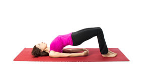Bridge Pose in Yoga and Pilates. Young woman doing Bridge Pose in Yoga and Pilates (Series with the same model available Royalty Free Stock Photography