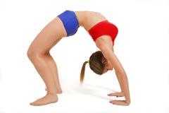 Bridge pose. Young woman doing Yoga exercises in studio on white background. Bridge pose - Urdhva Dhanurasana Royalty Free Stock Images