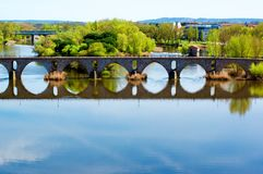 Bridge Puente de Piedra across River Douro in Zamora. Bridge Puente de Piedra across River Douro with Water Reflection in Sunny Day on Cityscape background stock image