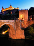 Puerta de Alcantara and Alcazar, Toledo. The bridge of Puerta de Alcantara in front of the Alcazar, an originally Moorish castle in Toledo, a medieval town south Royalty Free Stock Image