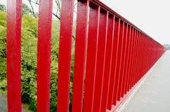 Bridge railing painted red background closeup Stock Images