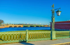 The bridge railings. The beautiful green forged railings with double-bitted axes of the Ioanovsky Bridge, the first bridge of Saint Peterburg Royalty Free Stock Photography