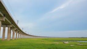Bridge of railway cross grass field meadow Royalty Free Stock Images