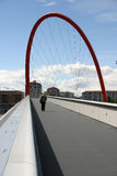 Bridge with red arch. Long bridge with tall red arch in Torino, Italy Stock Photo