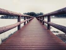 Bridge. Red Wooden Bridge Walkway in The Swamp Landscape Head to The Park in Art Style Stock Image