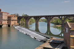 A bridge is reflected in the river. After a bridge,a chute regulates the course of the tarn river,albi(france stock images