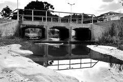 Bridge reflected on the water Stock Image