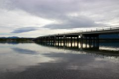 Bridge reflecting in lake in Tagish, Yukon, Canada. The tiny town of Tagish is located not far from Whitehorse and Carcross in Canada's Yukon Territory, close to Stock Image