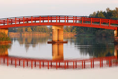 Bridge reflecting from river Stock Images