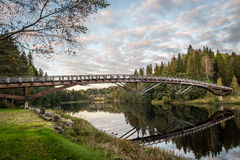 Bridge reflecting in river. Picture from kjerrafossen in Norway. The calm water makes a beautiful reflection of the bridge Stock Images