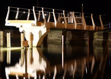 Bridge reflecting in water in Mirangi Bayat at night. Lights on bridge reflecting in waters in Mirangi Bayat at night Stock Photography