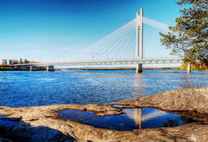Bridge with reflection in puddle. On coast Royalty Free Stock Photos