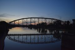 Bridge and reflection in Waco Texas in May 2018. Bridge in Waco Texas in May 2018, was on my way home when the sun was setting and i just had to watch the sun royalty free stock photo