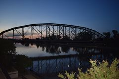Bridge reflection in Waco Texas in May 2018. Bridge in Waco Texas in May 2018, was on my way home when the sun was setting and i just had to watch the sun set in stock photography