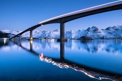 Bridge and reflection on the water surface. Natural landscape in the Norway Stock Images