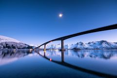 Bridge and reflection on the water surface. Natural landscape in the Lofoten islands, Norway. Architecture and landscape royalty free stock image