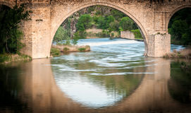 Bridge reflects in river of Toledo, Spain, Europe. Royalty Free Stock Photo