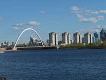 Bridge and residential buildings. Astana, view on bridge from seafront, some residential buildings near the river Ishim Stock Images