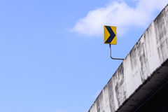 Bridge and right arrow sign with blue sky Stock Photography