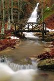 Bridge on the river. Near the waterfall Stock Photography
