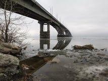 The bridge through the river Stock Images
