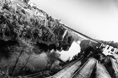 Bridge on a River. Black and white shot of a bridge over river Royalty Free Stock Images