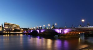 Bridge Beside River and City Lights during Night Time Royalty Free Stock Photos