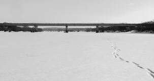 Bridge on the river. Concrete bridge over the frozen river Royalty Free Stock Image