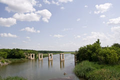 Bridge on the river. Destroyed bridge on the river Stock Photo