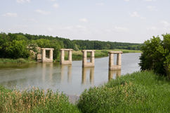 Bridge on the river. Destroyed bridge on the river Royalty Free Stock Photography