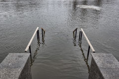 The bridge at the river flooded Royalty Free Stock Photo