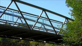 The Bridge on the River, Light Fx. Modern Bridge on the River and Cycle Route stock video footage