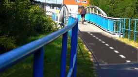 The Bridge on the River, Light Fx. Modern Bridge on the River and Cycle Route stock footage
