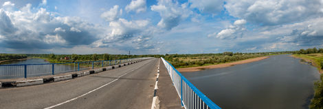 Bridge on the River Lovat. Bridge  in Starorussky district Novgorod Region on the River Lovat. Panorama Royalty Free Stock Photos