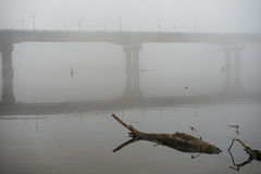 Bridge through river in misty morning Stock Photography