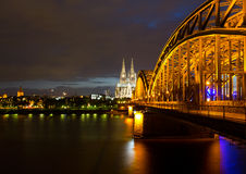 Bridge on River Rhine against Cologne Cathedral at night Royalty Free Stock Photography