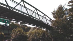 The Bridge on the River and small train, Light Fx. Modern Bridge on the River and Cycle Route stock video footage