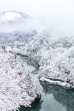 Bridge on a river with snow mountain, Fukushima. Royalty Free Stock Image