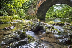 Bridge river. Stone Bridge with a river running beneath Stock Images