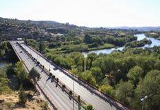 Bridge through the river Tajo.  Toledo landscape, Spain. Royalty Free Stock Images