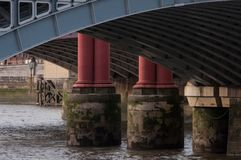 Bridge on the river Thames. A view of the arch of a bridge over the river Thames showing the construction royalty free stock photo