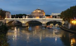 Bridge on river Tiber and Castel Saint Angelo at background royalty free stock photography
