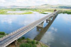 The bridge through the river on two coast Stock Photo