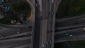 Bridge road aerial top view with truck and car passing buy during sunset Golden Hour in Riga, Latvia Spring 2019. Under construction bridge stock video