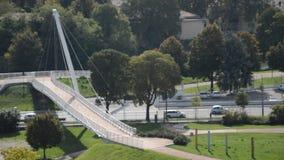 Bridge on the road. Bicycle bridge on the traffic road stock footage