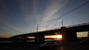 Bridge and road traffic during the sunset stock video footage