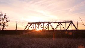 Bridge road. Train traffic transportation. Timelapse railway bridge on sunrise stock video footage